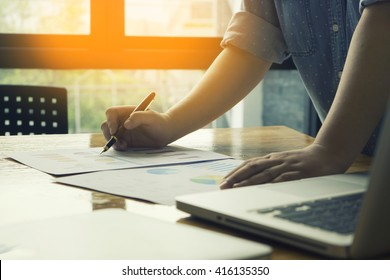 Male manager putting his ideas and writing business plan at workplace,man holding pens and papers, making notes in documents, on the table in office,vintage color,morning light ,selective focus. - Shutterstock ID 416135350