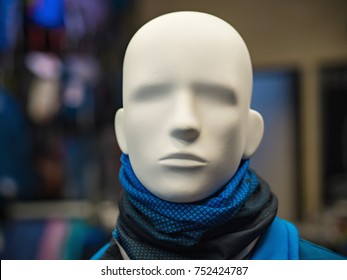 Male mannequin in the background of a sports store under artificial lighting