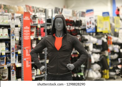 Male mannequin wearing sport clothing in a sporting goods retailer
