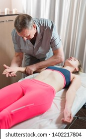 Male manual visceral therapist masseur treats a young female patient. Work with the subconscious to indicate problems