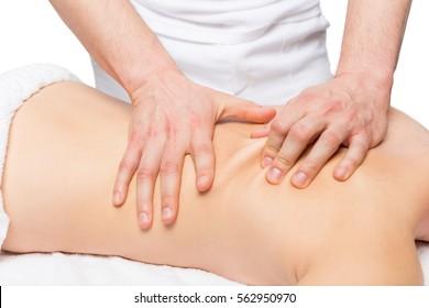 male masseur does back massage on a massage table