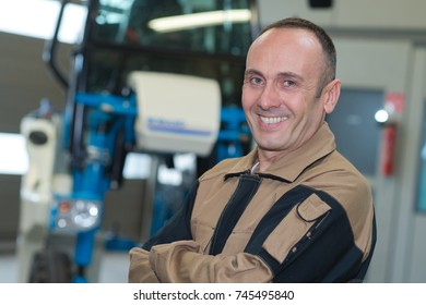 male mature worker smiling in a warehouse