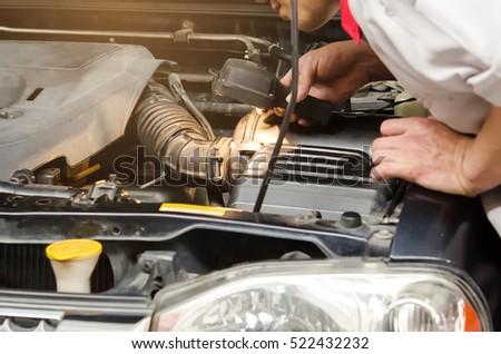 male mechanic flashlight examining car engine stock photo edit now