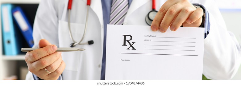 Male medicine doctor hand hold clipboard pad and give prescription to patient closeup. Panacea, life save prescribe treatment legal drug store contraception concept. Empty form ready to be used
