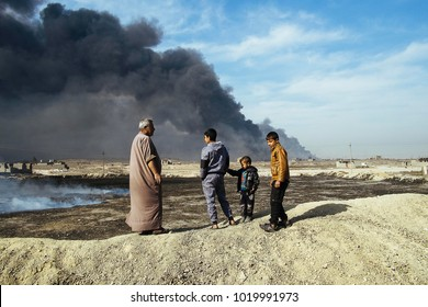 Male member of an Iraqi family looking an oil well set on fire by the ISIS to slow down the coalition's advance, the fire was extinguished.