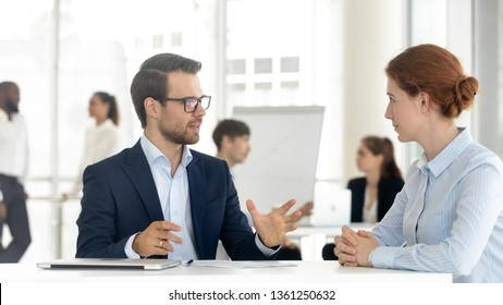 Male mentor insurance broker or bank manager consulting client making business offer at meeting, salesman insurer speaking sell services talking with customer explaining loan deal benefits in office