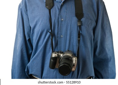 A male mid-section, wearing a blue dress shirt, with an SLR camera hanging.