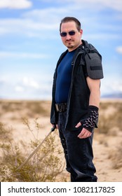 A male militia soldier in a post apocalyptic desert wasteland. Urban combat and wasteland inspired