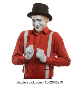 Male mime artist on white. Talented actor showing embarassment and giving a shy smile.