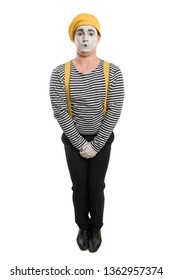 Male mime artist wants to pee, holding his crotch. Funny pantomime. Man with white face makeup and stage clothes.