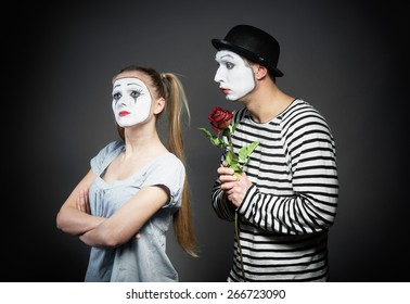Male mime giving a flower to female mime