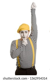 Male mime as a referee, isolated on white background. Judge whistling and showing red card. Pantomime and sport concept.