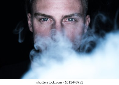 male model blowing out some smoke, shisha smoking picture, smoking background