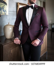 Male model in custom tailored tuxedo, suit posing indoors