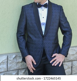 male model dressed with tuxedo is having a photo shooting