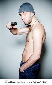Male model with gun posing, studio isolated shot