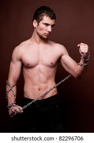 Male model posing with chains