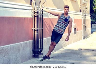 Male model posing on street