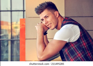 Male model posing on the terrace of a cafe