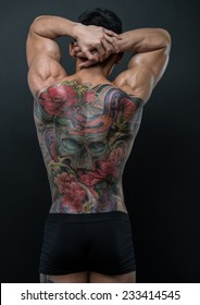 Male model with a snake and skull tattoo