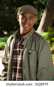 Male model standing outside smiling