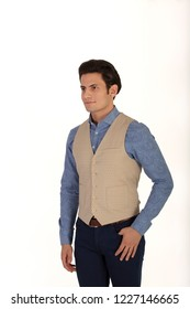 Male model in the studio wearing vest. Classic waistcoat isolated on white background.