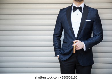 Male model in a suit with a cigar