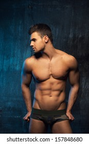 Male model in underwear watching to the left