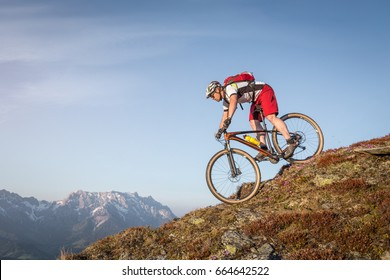 Male mountainbiker on a trail in the mountains