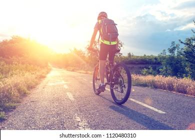 Male mountainbiker at sunset