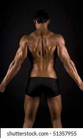 male muscular back on black background.