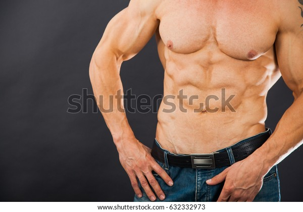 Male muscular torso with six pack abs. Amazing figure. Cutting phase