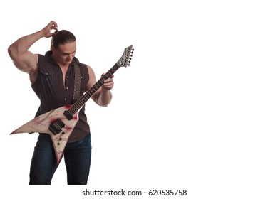 Male musician bodybuilder with long hair and electric guitar in hands posing and playing on white background
