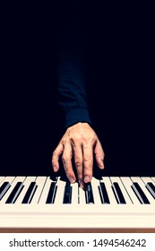 male musician hand playing on piano keys. music background