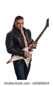 Male musician with long hair in a leather jacket and with an electric guitar in his hands posing and playing on a white background