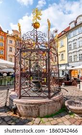 Male namesti fountain in Prague old town, Czech Republic