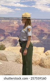 Male National Park ranger looking at South Rim of Grand Canyon National Park in mid-summer in Arizona