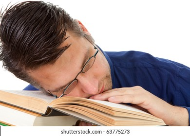 male nerdy geek fall asleep with face on pile of books over white background