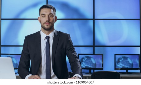Male News Presenter in Broadcasting Studio.