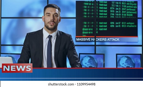 Male News Presenter Speaking About Massive Hacker Attack