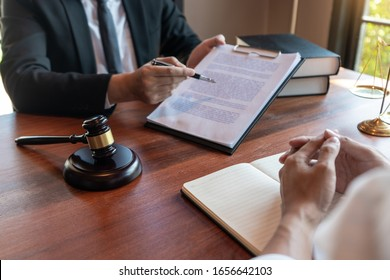 Male Notary lawyer or judge consult or discussing contract papers with Businessman client in office, Law and Legal services concept.