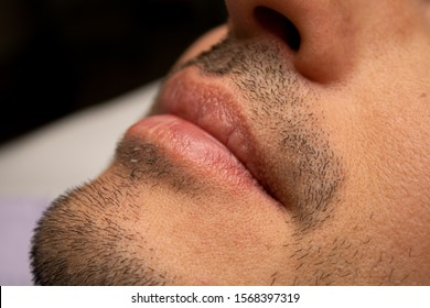 Male NU Lips. Young man closeup lips, male permanent make up, men's bristle.