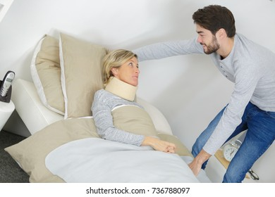 male nurse helping patient on bed
