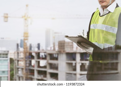 male occupational health and safety officer inside factory doing inspection with light effect