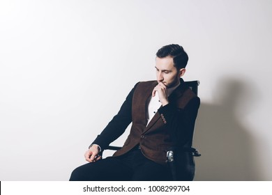 male office worker meditating on an armchair