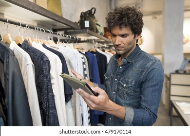 Male owner of Fashion Store with digital tablet computer