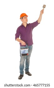 male painter in hardhat with brush in his hands isolated on white background