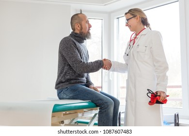 male patient is consulting a female doctor in her office or practice