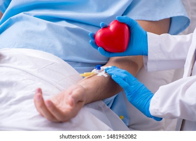 Male patient getting blood transfusion in hospital clinic
