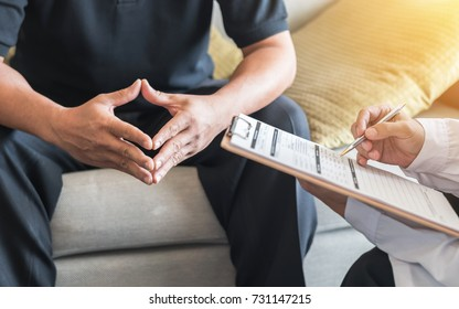 Male patient having consultation with doctor or psychiatrist who working on diagnostic examination on men's health disease or mental illness in medical clinic or hospital mental health service center - Shutterstock ID 731147215